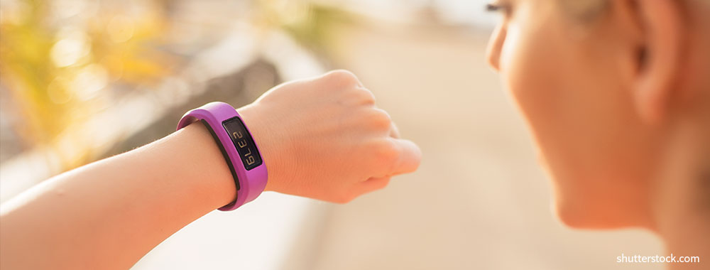 woman-checking-fitness-and-health-tracking-wearable-device